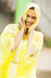 pretty woman dress in raincoat having fun in the rain