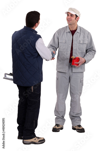 Two manual worker stood together