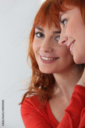 woman looking herself in the mirror