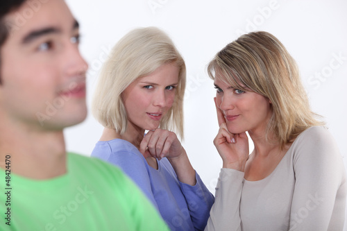 Women observing a man