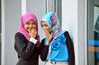 Young asian businesswoman in head scarf  chat togetherm