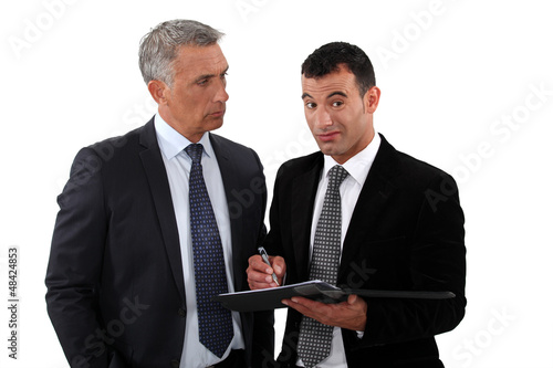 Two businessmen interacting on white background