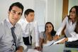 Businessteam gathered around desk