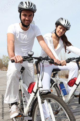 young couple on bicycle