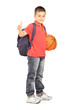 School boy with backpack holding a basketball and giving a thumb