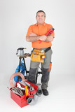 Studio shot of a plumber with tools of the trade