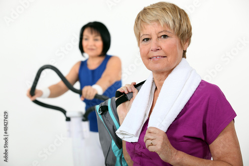 Two middle-aged women at the gym