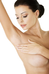 Woman's touching her armpit
