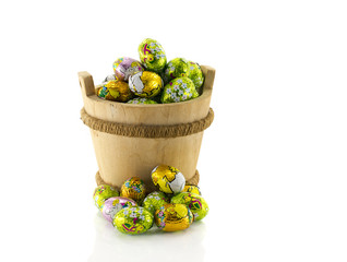 wooden bucket with easter eggs