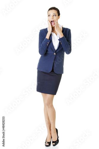 Full portrait of shocked businesswoman