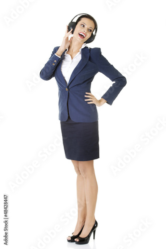 Attractive businesswoman with headphones