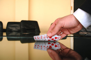 Businessman holding playing cards