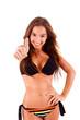 Beautiful bikini woman showing thumbs up