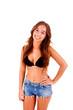 Beautiful young woman dressing bikini and shorts