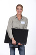 Woman delivering computer monitor