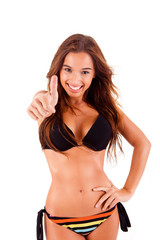 Beautiful bikini woman showing thumbs up