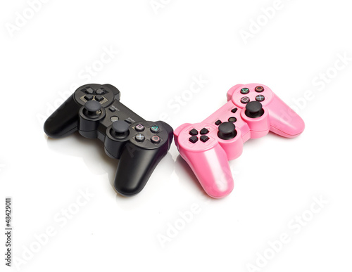 Pink and black gamepads isolated on white background