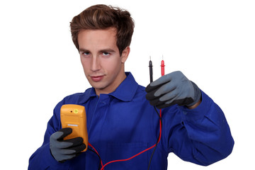 an electrician using an ammeter