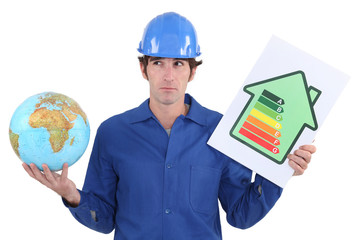 Tradesman with a globe and energy rating sign