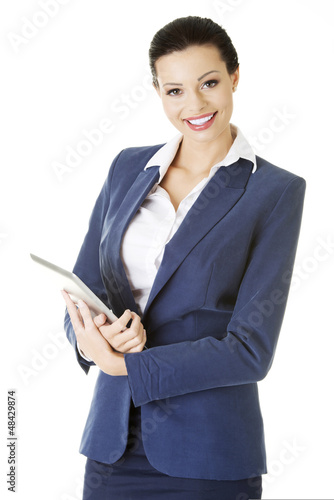 Attractive businesswoman using tablet computer