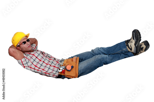 Tradesman lying in an invisible hammock