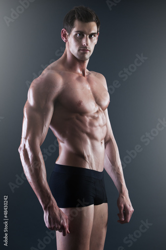 Portrait of a young muscular man in underwear