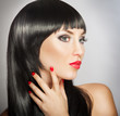 Woman with bright red lips and manicure, black hair