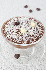 chocolate mousse with chocolate hearts decorated with coconut