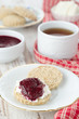Scone with goat cheese and jam for breakfast closeup