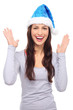 Woman in Santa hat gesturing