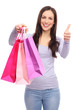 Woman with shopping bags and thumbs up