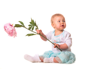 baby is holding a flower