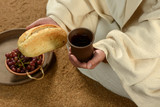 Jesus Hands Holding Bread and Wine