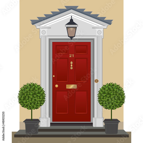 Door. Traditional red painted front door with bay trees  s