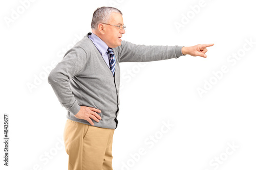 Angry mature man pointing with finger