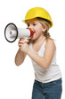 Little girl builder in yellow helmet screaming into loudspeaker