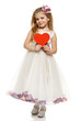 Little girl in princess dress holding heart shape