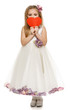 Adorable girl in princess dress holding heart shape