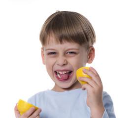 boy eating lemon