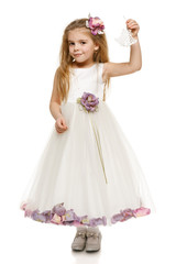 Adorable 6 years old girl in princess dress holding bells