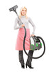 Full length portrait of a blond housewife holding a vacuum clean
