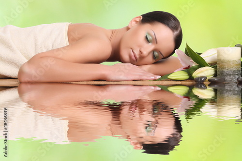 young healthy girl relaxing in spa