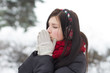 Girl warming her hands in winter