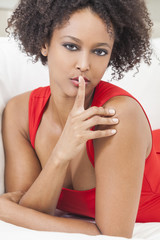 Mixed Race African American Girl Finger on Lips