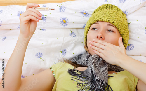 Sick woman have temperature