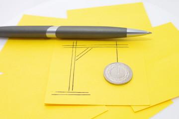 Złotówka na szubienicy długopis