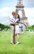 Closeup of happy positive couple hugging near the Eiffel tower