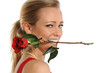 Young Woman Biting Rose