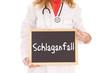 Ärztin mit Schild - Schlaganfall