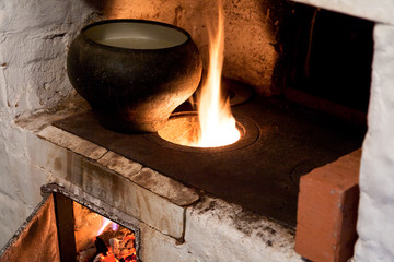 oven and old cast-iron pot